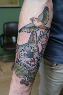 Tattoo kat met vogeltje